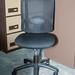 Black mesh back swival chair