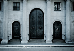 Gringotts (Skuggzi) Tags: door old england sculpture white black building london history metal stone mystery architecture bronze facade arch symbol britain outdoor pillar mysterious british desaturated column banking symbolism cityoflondon finance symbology