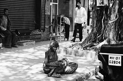Beggars in Mumbai, India (Ales Dusa) Tags: poverty street travel portrait people india film face analog asia beggar chilling mumbai awful praktica fx2 rawstreets flickrtravelaward