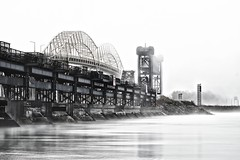 lake superior compensating works, sault ste. marie (twurdemann) Tags: longexposure autumn mist ontario water weather fog unitedstates dam michigan lakesuperior bleachbypass internationalbridge stmarysriver verticalliftbridge neutraldensityfilter unitedstatesborder nikcolorefex canadaborder nd106 circa1921 internationalrailroadbridge lakesuperiorcompensatingworks internationaljointcommission xf55200mm watercontroldam fall2015