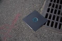 Street Tunes (J.D.-Snaps) Tags: record album lp grate street pavement asphalt music tunes discarded trash sewer drain