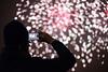 Watching Fireworks (Rixoon) Tags: fireworks night colors bokeh gothenburg göteborg fyrverkeri gpnyårsfyrverkeri red new year nikon d610 fx 50mm depthoffield newyear