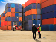 Businessman with foreman logistics engineer is standing (Krunja) Tags: aec architectural asia asian background boss box business car cargo commerce commercial construction containers control crane customs delivery dock economy engineer engineering export female foreman forklift handling harbour import industrial industry international inventory job leader leadership loading logistics man management manager port professional project ship shipping site stack stacking terminal thailand trade transport transportation truck warehouse worker yard