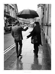 Umbrella dilemma (Artisticus Farticus) Tags: umbrella rain mono strand derby olympuspenf zuiko12mmf2 grabshot candid