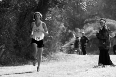 Runner and Observer (Jonas Powell) Tags: college sports race athletics university williams cross connecticut sony country running middlebury varsity finals powell tufts bates xc jonas amherst 70200 f4 tuft colby bowdoin conn wesleyan nescac a6000