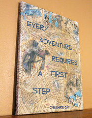 IMG_1850a (Deronda and Noelle) Tags: sign aliceinwonderland repurposed recyled mixedmediaart canvasart bookpages thecheshirecat