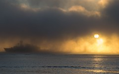Shipping Sunrise (corybeatty) Tags: sunrise mist fog light sun morning halifax nova scotia canada ship boat cloud clouds ocean sea beach landscape