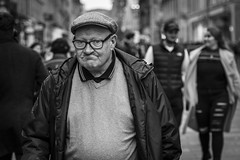 Pop Will Eat Himself (Leanne Boulton) Tags: people monochrome depthoffield urban street candid portrait portraiture streetphotography candidstreetphotography candidportrait eyecontact candideyecontact streetlife old aged elderly man male face facial expression look emotion feeling eyes mouth cap glasses tone texture detail bokeh natural outdoor light shade shadow city scene human life living humanity society culture canon 5d 5dmarkiii 70mm character ef2470mmf28liiusm black white blackwhite bw mono blackandwhite glasgow scotland uk
