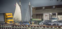 Sail Behind Wharf (PAJ880) Tags: industry boston ma army south sails trucks base sloop