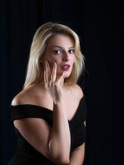 Anelise 3 (Complete Buffoon) Tags: portrait woman girl blackbackground posing blonde redlipstick blackdress