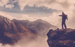 Trekker (Janne Ulvinen) Tags: sky italy mist mountains alps fog trekking canon italia cloudy hiking alpine mountaineering alpen montagna alpinista pontedilegno