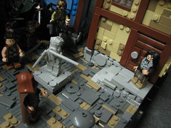 LoM UC: 6 (Micah the Fire-Breathing Hobbit) Tags: city roof horse statue wall soldier army riot hand lego stonework crowd medieval tudor cobblestone story fantasy hood cloak tale lom warg grueling