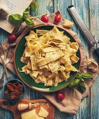 Papardelle italian pasta with fresh cherry tomatoes and basil (CreativePhotoTeam.com) Tags: travel italy food white hot cooking kitchen yellow closeup cheese breakfast dinner vintage tomato cherry recipe table lunch cuisine restaurant book healthy italian mediterranean village dish sauce background rustic knife fork pasta steam delicious health hunger meal vegetarian garlic carbohydrate hungry spaghetti picturesque tagliatelle cuttingboard ingredient smelting pappardelle driedtomatoes justcooked