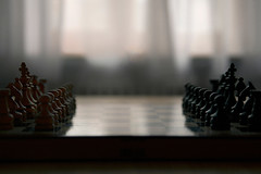 """""""High Noon"""" (helmet13) Tags: game window backlight king raw bokeh chess competition queen knight rook bishop strategy echecs pawn studies gettyimages chessboard échecs selectivefocus chessmen aoi 100faves échiquier peaceaward heartaward world100f platinumpeaceaward d800e"""