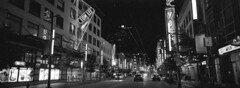 Granville Night (Orion Alexis) Tags: 35mm film analog panorama xpan fujifilm tx1 widescreen granville street lights night city vancouver canada nightlife ilford delta 400 blackandwhite black white