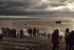 The lifeboats are leaving... (sarahgiles2) Tags: devon eastdevon lifeboats lifeboatcrew rnli christmasdayswim christmasswimming budleighsalterton jurassiccoast seaswim coldwaterswim seaswimming seaswimmers