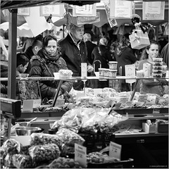 Nuts (John Riper) Tags: johnriper street photography straatfotografie square vierkant bw black white zwartwit mono monochrome netherlands candid john riper canon 6d 24105 dordrecht market nuts stall woman lady people eye contact