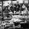 Nuts (John Riper) Tags: johnriper street photography straatfotografie square vierkant bw black white zwartwit mono monochrome netherlands candid john riper canon 6d 24105 dordrecht market nuts stall woman lady people eye contact
