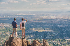 Enjoying the views (DST-photography) Tags: phoenix arizona usa america american looking hike hiking camelback mountain hiker united states sun clouds view spectacular dramatic colour grading purple blue red rock valley city citycentre cityscape skyscape cumulus sunrays roads beautiful bw black white epic travel travelling plane pilot trainee buildings high desert monochrome landscape