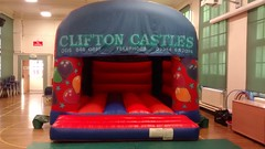 16x13 Celebration themed bouncy castle. Only £65 per hire.