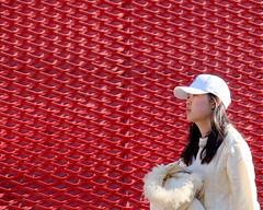Woman in White (Mondmann) Tags: womaninwhite woman white redbackground girl female walking hongdae seoul korea southkorea rok republicofkorea asia eastasia streetphotography mondmann fujifilmxt10