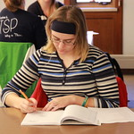 A student taking notes during the Writing Workshop.