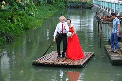 2015-10-18 Phuong & Håkan wedding268 (HAKANU) Tags: city wedding red love river groom bride boat pond couple photos husband vietnam phuong wife weddingpictures reddress håkan weddingphotos mytho bridalcouple håkanuragård