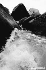 Water Enters (b&w) (The Baths, Virgin Gorda, BVI) (runintherain) Tags: ocean sea blackandwhite bw nature water canon outside island coast seaside shore caribbean atlanticocean bvi virgingorda thebaths canonxsi canon450dxsi runintherain devilsbaynationalpark virginislandsarchipelago virginislandsbritishvirginislands