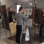 Art students drawing still life style drawings.