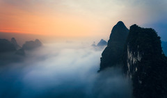 A Blanket Of Fog (One_Penny) Tags: lijiang china guangxi hills karst karsthills landscape liriver mountains nature photography river scenery view xingping fog foggy sunrise early morning mountain hill sky clouds longexposure ndfilter travel yangshuo xianggong asia