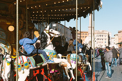Special Christmas (lorenzoviolone) Tags: childhood finepix fuji400h fujix100s fujifilm fujifilmx100s game lights navonasquare obelisk vsco vscofilm x100s carousel kid mirrorless playing strangers streetphoto streetphotocolor streetphotography walk:rome=dec292016 roma lazio italy