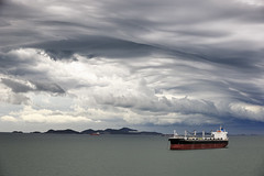 Clouds over Laem Chabang Anchorage (Mental Octopus) Tags: clouds nature cloudscape stormclouds dusk thailand laemchabang anchorage freightship freightnavigation seatrade ship asia tanker landscape seascape