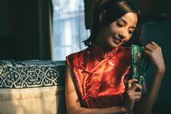 DSC00560 (Spyrosis) Tags: woman portrait fashion female asian model cute beauty chinese new year red qipao dress lomography achromat