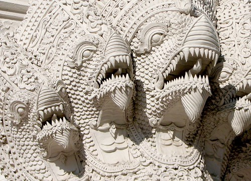 Ornate white statue of mythical beasts