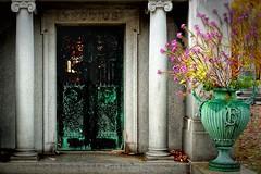 Rhodius 9314 w (GlasseyeA) Tags: flowers cemetery grave urn bronze wind indianapolis columns crypt crownhill rhodius