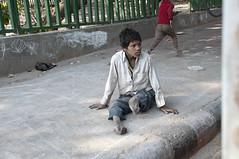 INDIA7359/ (Glenn Losack, M.D.) Tags: street people india cars kids portraits children photography delhi muslim islam poor photojournalism buddhism impoverished flip flops local hindu begging scenics handicapped deformed beggars tuc glennlosack losack glosack dahlits