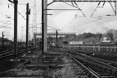 The Overhead (Bieomax) Tags: uk bw white black grass yard train four foot 4 hill stock rail points depot network patch care scrub rolling sleeper ballast catenary neville ohe ohle 25kac