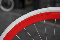 Red wheel (Jan van der Wolf) Tags: map119106v bike fiets bicycle wheel wiel wielen spaken spokes dof depthoffield scherptediepte composition compositie lines line curve