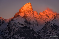 Grand Opening (kevin-palmer) Tags: grandtetonnationalpark nationalpark grandteton tetonmountains glacierview wyoming winter december cold snow snowy clear sunshine sunlight gold golden yellow light orange red nikond750 nikon180mmf28 telephoto wind windy gusty early morning sunrise dawn peak summit newyearseve firstlight