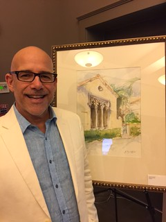 Carlos Barbon with his exhibit of watercolors at the Coral Gables Museum