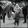 At a Christmas market (* RICHARD M (Over 5.5 million views)) Tags: street candid mono blackwhite happyfamilies families crowd shoppers shopping christmasshopping crowds christmasmarket market cobblestones stgeorgesplateau stgeorgeshall liverpudlians scousers liverpool merseyside europeancapitalofculture capitalofculture december winter winterclothes winterclothing streetstyles keepingwarm allwrappedup unescomaritimemercantilecity maritimemercantilecity christmasshoppers