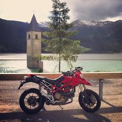 My Ducati Hypermotard posing (Cloud hiker) Tags: curonvenosta trentinoaltoadige italia it ducati hypermotard motorbike lake lago resia