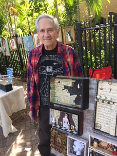 Artist Michael Tamers with some of his artwork at the Gifford Lane Art Stroll