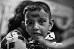 The Grabber (alisdair jones) Tags: ef35mmf14lusm portrait boy child nainativu srilanka