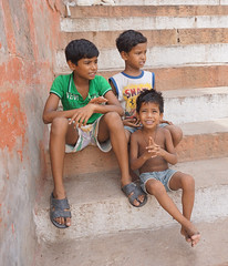 Young boys happily looking at camera (phuong.sg@gmail.com) Tags: poverty life street camera city people urban india abandoned stairs person trapped solitude sitting loneliness child looking little fear small steps young social scene orphan tired depression varanasi remote emotional economic staring stress issues survival sandal disappointment slum abuse grief ganges terrified homelessness