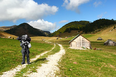 A hiker passing by (jonykadi) Tags: road travel white black green nature hike balkans montenegro biogradska
