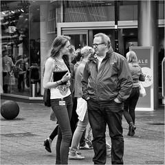Greenpeace chat (John Riper) Tags: johnriper street photography straatfotografie square vierkant bw black white zwartwit mono monochrome netherlands candid john riper canon 6d 24105 l beurs hoogstraat interview girl man woman lady gentleman sale tmobile beursplein zwvk window reflections shop