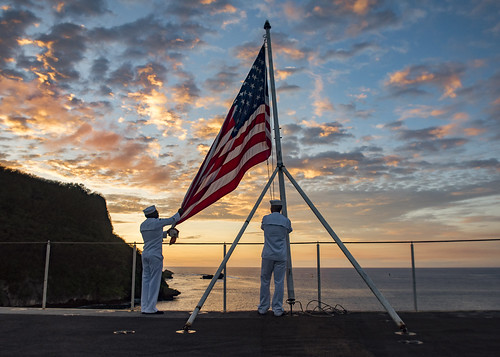 From flickr.com: Sailors perform evening colors. {MID-71669}