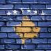 National Flag of Kosovo on a Brick Wall