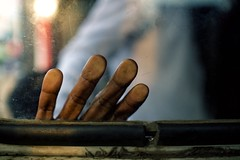 Gekko (alisdair jones) Tags: ef35mmf14lusm hand fingers prints bus window srilanka